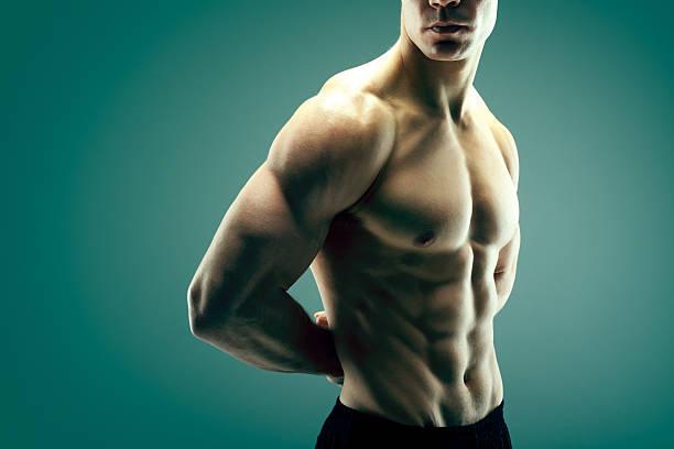 cuerpo fuerte - hombres grandes musculosos fotografías e imágenes de stock