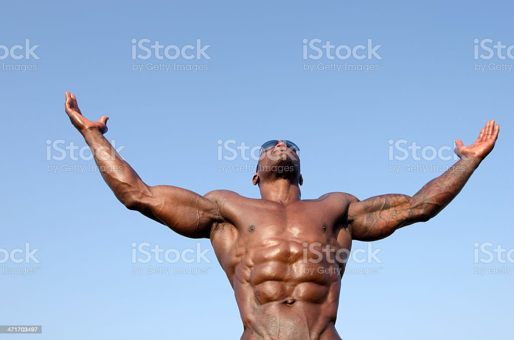 Strong bodybuilder man with perfect abs,biceps, triceps and chest stock photo
