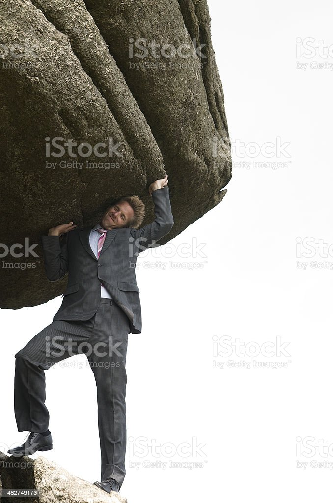 Strong Businessman Holding Up Heavy Boulder White Background Outdoors stock photo