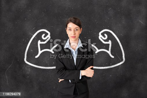 Strong businesswoman with drawn powerful arms