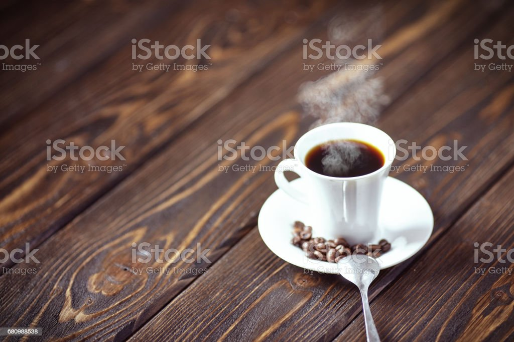 Strong coffee on the wooden background. Fresh coffee. royalty-free stock photo