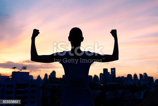 istock Strong confident woman in the city 525338631
