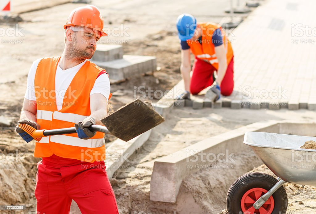 Strong construction worker stock photo