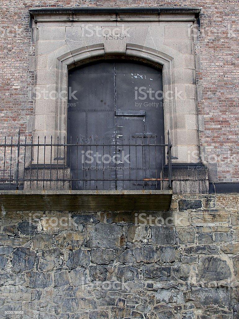 Strong door in brick building stock photo