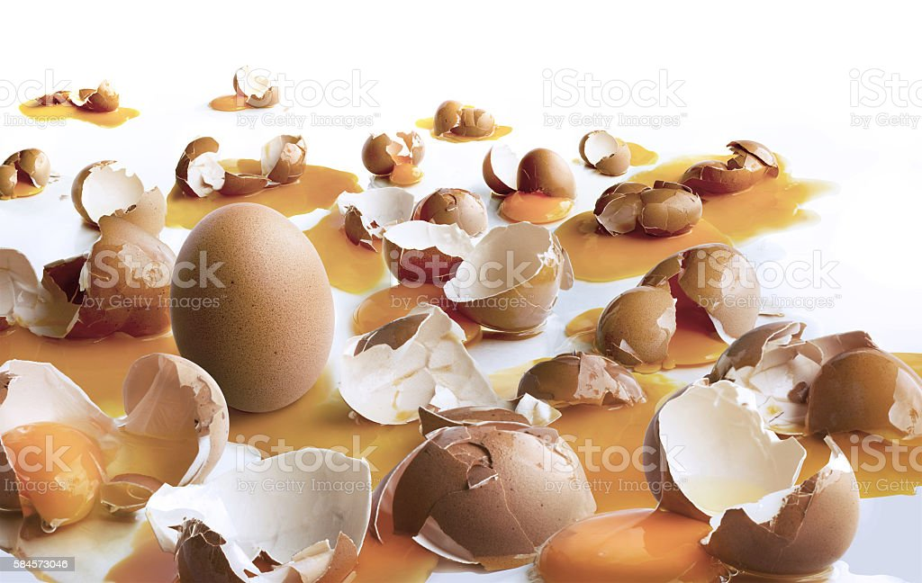 Strong egg standing with many broken egg.business motivation con stock photo