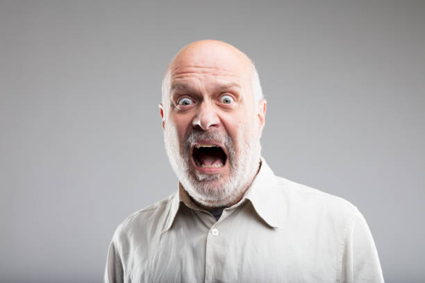 strong exaggerated fear expression of an old man - fear stock photos and pictures