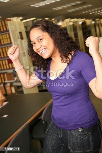 488149772istockphoto Strong Female College Student in the Library 174684241