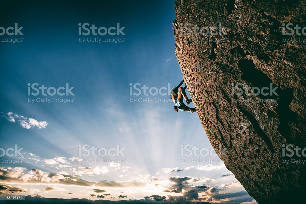 strong female rock climber stock photo