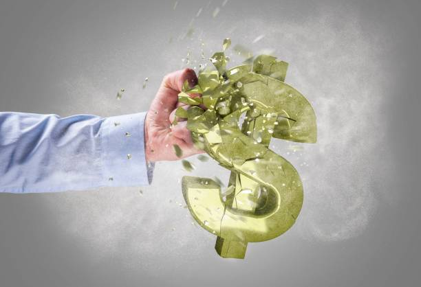 Strong fist punching the dollar symbol stock photo