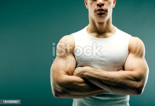 618638418istockphoto Strong guy with crossed arms 184999931