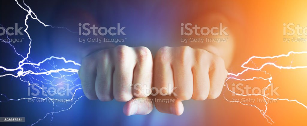 Strong hands catching thunders bolt - Power concept stock photo