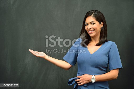 istock Strong Hispanic Woman Teacher 1055381628