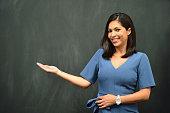 istock Strong Hispanic Woman Teacher 1055381628