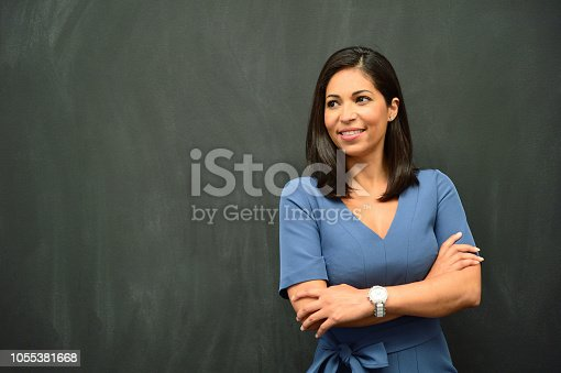 istock Strong Hispanic Woman Teacher 1055381668