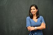 istock Strong Hispanic Woman Teacher 1055381668