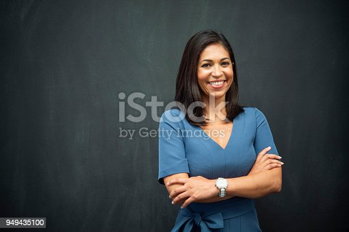 istock Strong Hispanic Woman Teacher 949435100