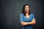 istock Strong Hispanic Woman Teacher 949435100