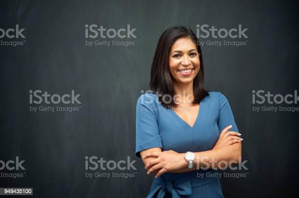 Strong hispanic woman teacher picture id949435100?b=1&k=6&m=949435100&s=612x612&h=iw3qjsq8tfx5tukquzmsm4jqlv1fhejx6 5zsnssqgg=