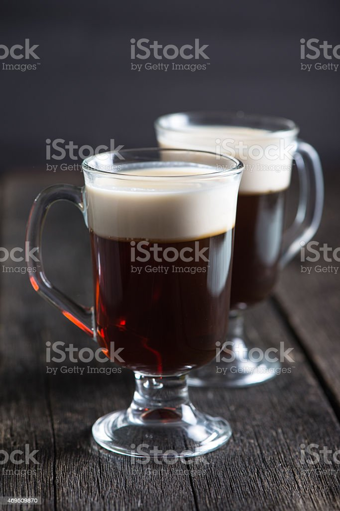 strong irish coffee on wooden table stock photo