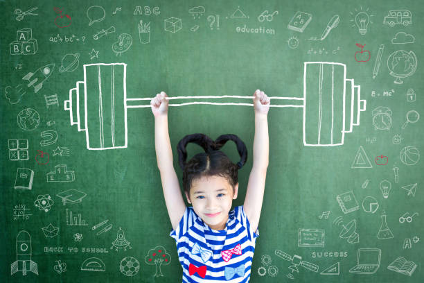 strong kid with weight lifting doodle on chalkboard for equal opportunity awareness on gender and children rights concept - postawa zdjęcia i obrazy z banku zdjęć