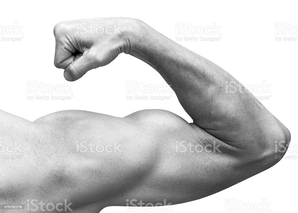 Strong male arm shows biceps. Close-up black and white stock photo