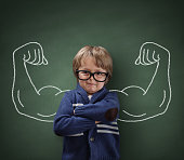 istock Strong man child showing bicep muscles 491445598