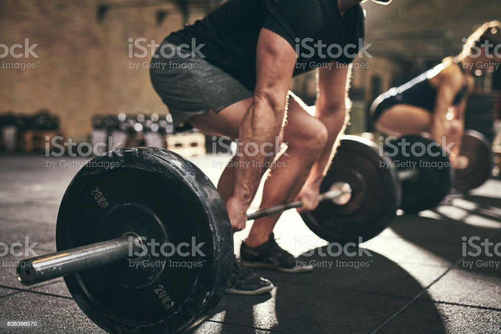 Strong man doing deadlift training in gym stock photo