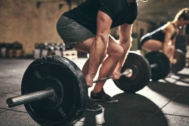 strong man doing deadlift training in gym - weights stock photos and pictures