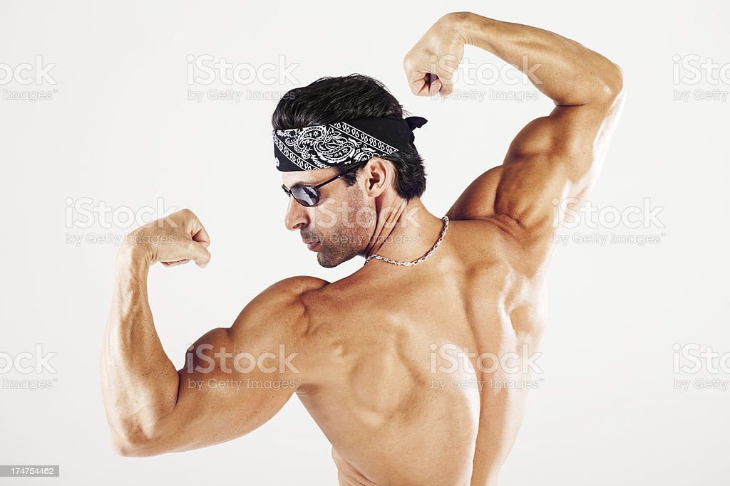 Strong man flexing muscles back view royalty-free stock photo