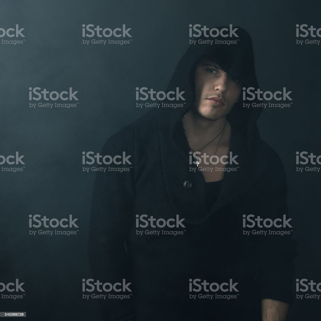 strong man in  black hoodie stock photo