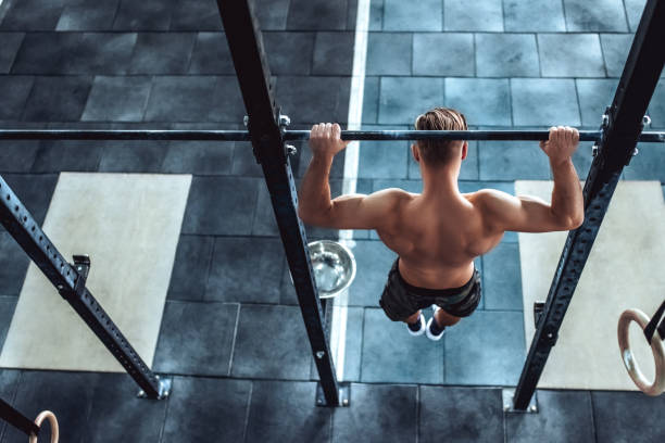 strong man in gym - horizontal bar stock photos and pictures