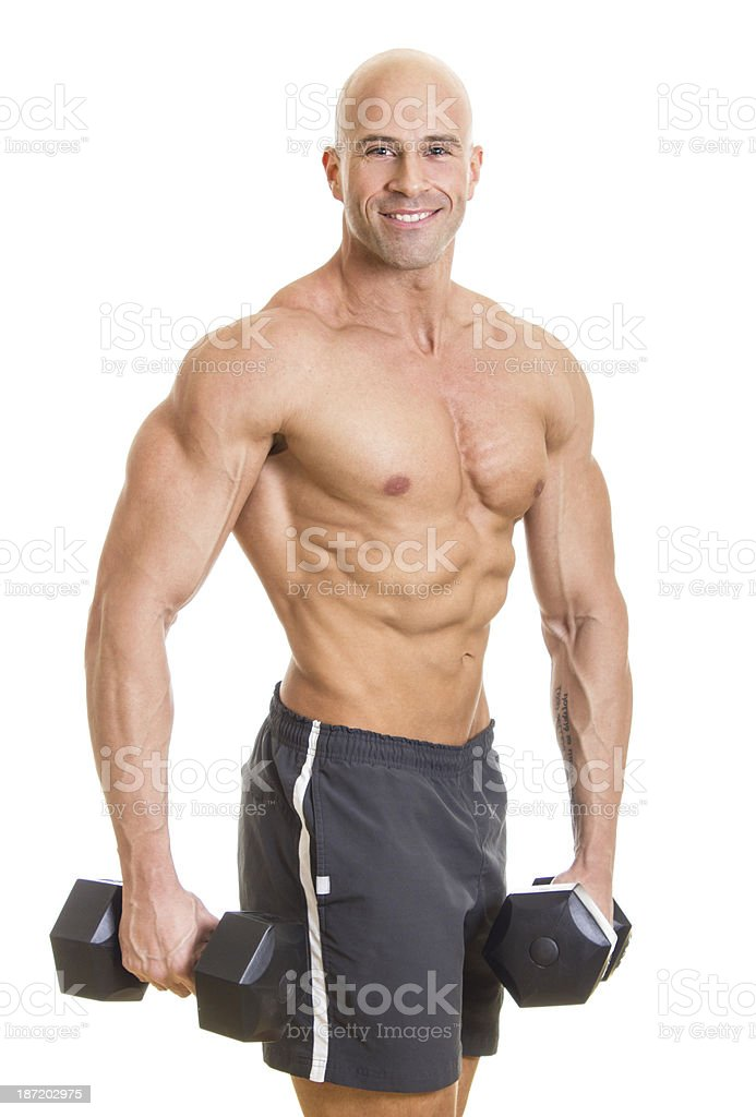 Strong man posing with dumbbell royalty-free stock photo