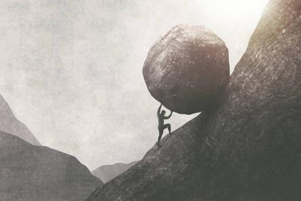strong man pushing big rock uphill, surreal concept stock photo