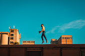 istock Strong man running and jumping on the top of the train wagon 1138942043