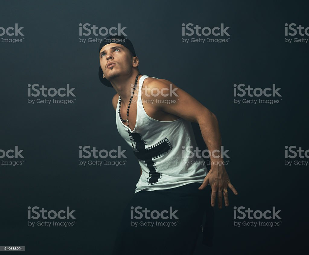 strong man stares up at  light stock photo