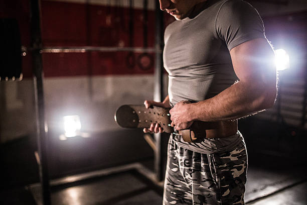 Strong man wearing protective belt stock photo