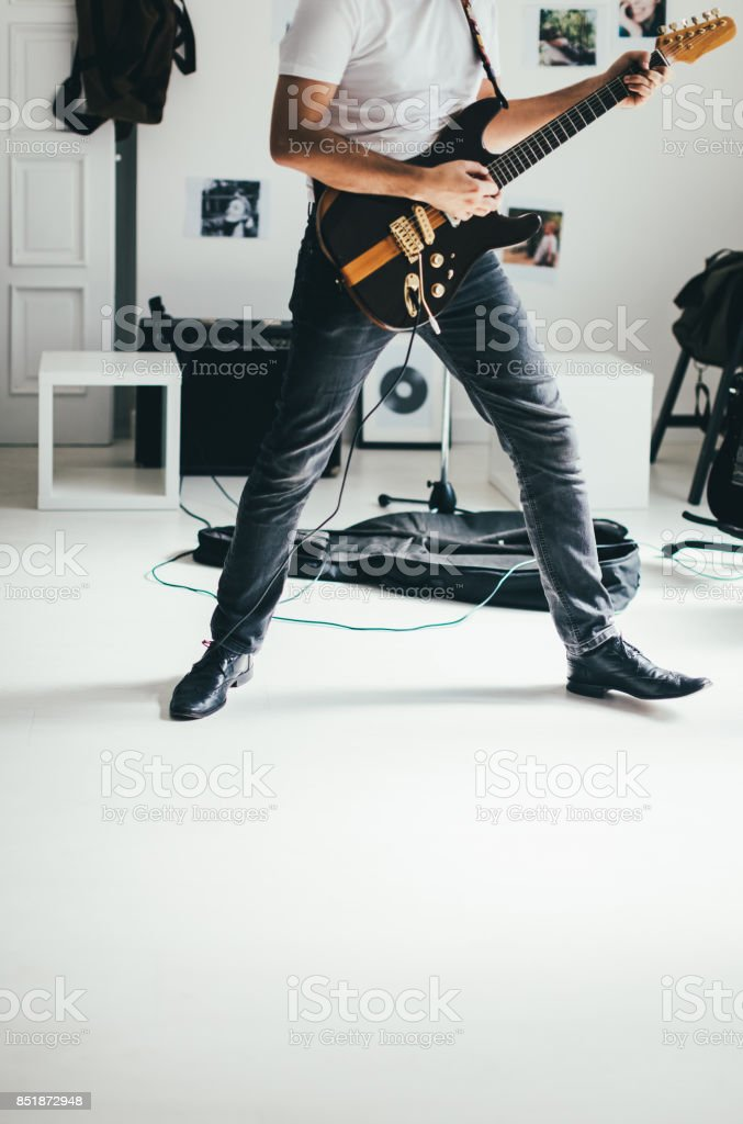 Strong man with guitar stock photo