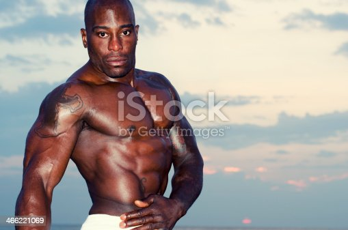 519676858istockphoto Strong man with perfect abs, shoulders,biceps, triceps and chest 466221069