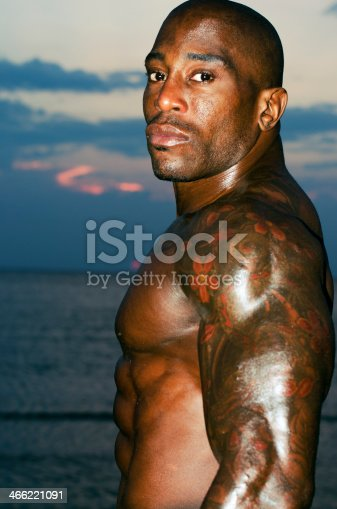 519676858istockphoto Strong man with perfect abs, shoulders,biceps, triceps and chest 466221091