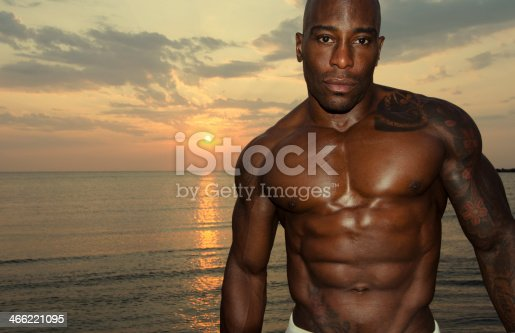 519676858istockphoto Strong man with perfect abs, shoulders,biceps, triceps and chest 466221095