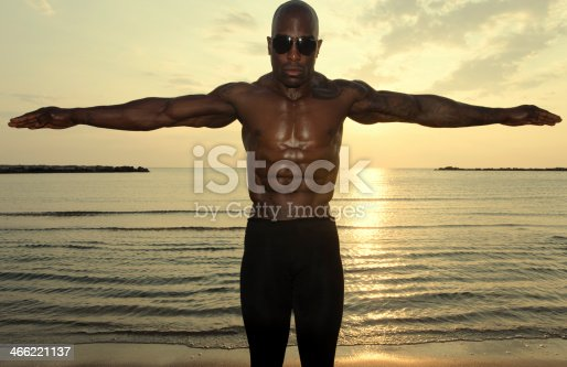 519676858istockphoto Strong man with perfect abs, shoulders,biceps, triceps and chest 466221137
