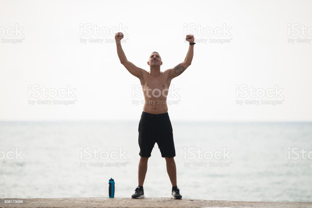 Strong muscled man showing his power stock photo