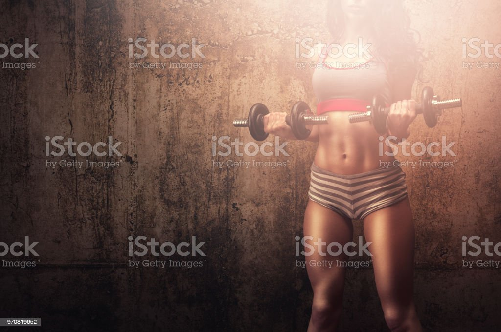 Strong muscles athletic woman stock photo
