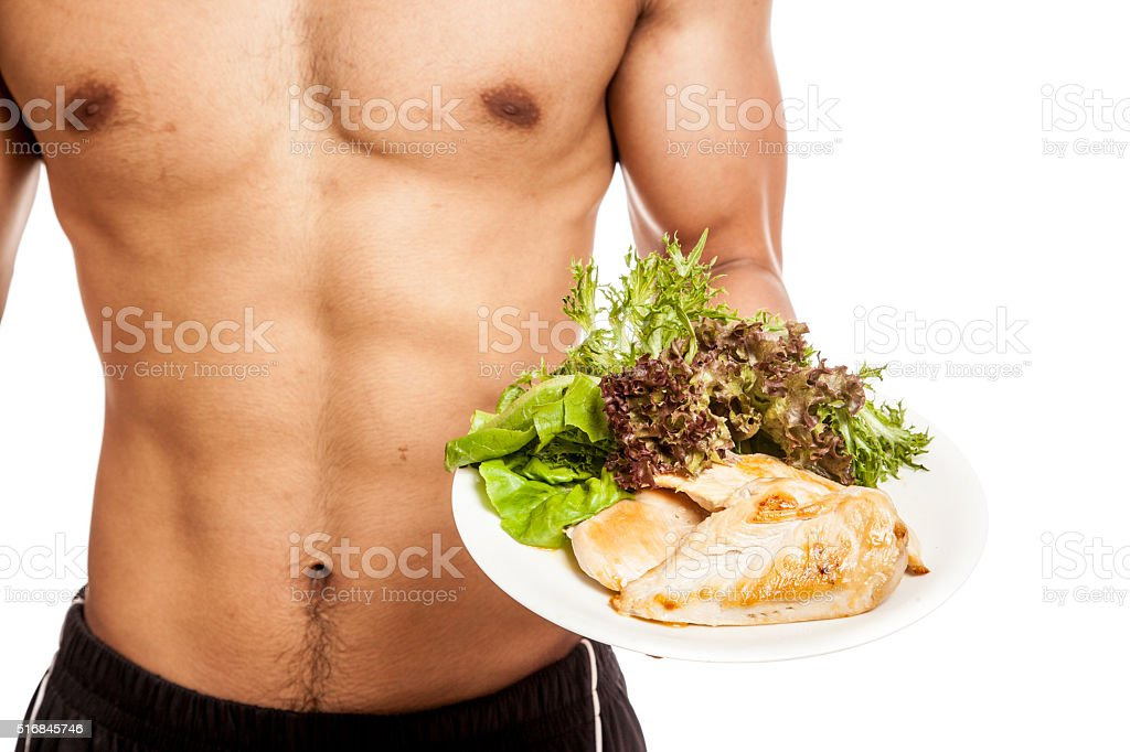Strong muscular Asian man with clean food stock photo