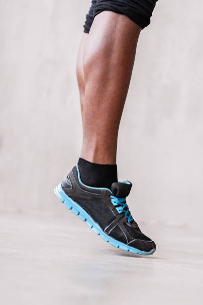 Strong muscular athlete training cardio exercises stock photo