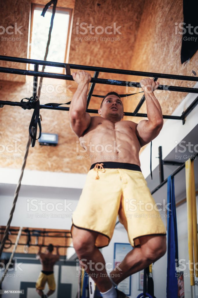 Strong Muscular Man Doing Pull Ups On The Bar Stock Photo