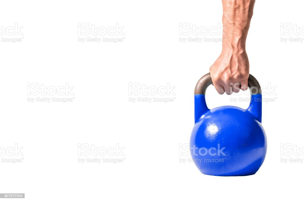 Strong muscular man hand with muscles holding dark blue heavy kettlebell partially isolated on white background - Royalty-free Barbell Stock Photo