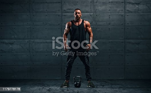 istock Strong Muscular Men, Cross Training Athlete Exercise With Kettlebell. Copy Space 1179778178