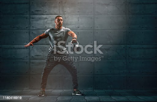 istock Strong Muscular Men, Cross Training Athlete Exercise With Kettlebell. Copy Space 1180416919