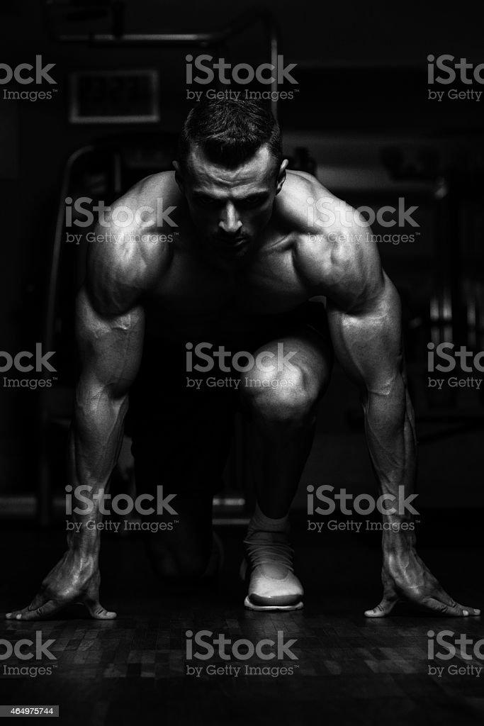 Strong Muscular Men Kneeling On The Floor stock photo